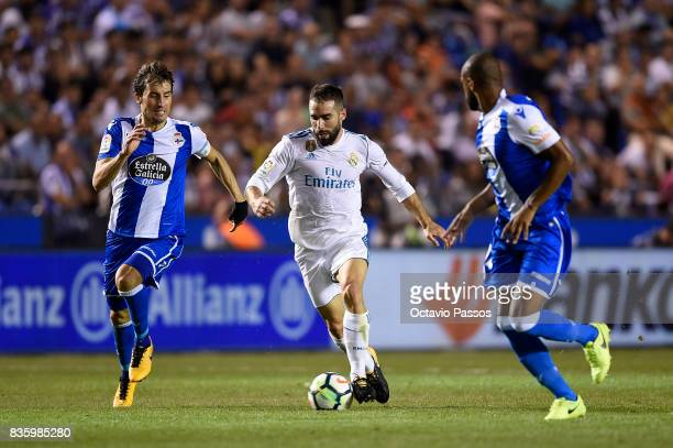 Pedro Mosquera of RC Deportivo La Coruna competes for the ball with Dani Carvajal of Real Madrid during the La Liga match between Deportivo La Coruna...