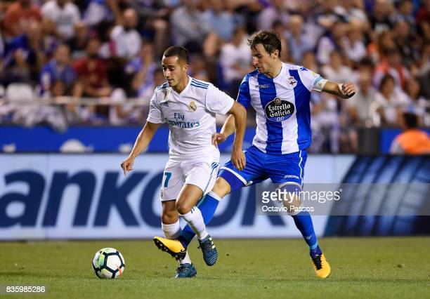 Pedro Mosquera of RC Deportivo La Coruna competes for the ball with Lucas Vazquez of Real Madrid during the La Liga match between Deportivo La Coruna...