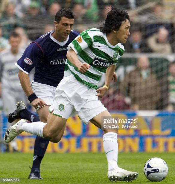 Pedro Moutinho of Falkirk looks to tackle Shunsuke Nakamura of Celtic during the Clydesdale Bank Premier League match at Falkirk Stadium Falkirk