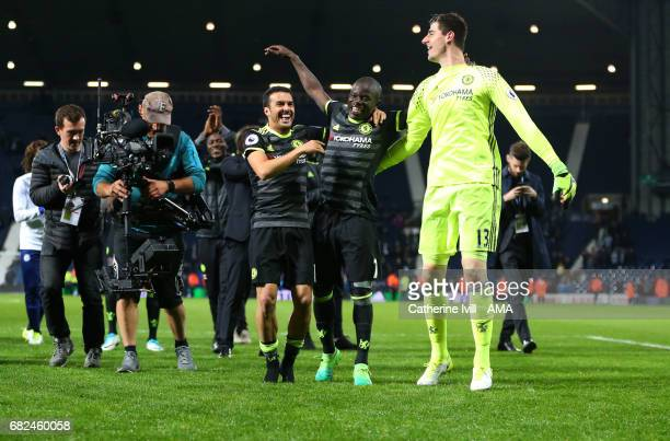 Pedro N'golo Kante and Thibaut Courtois of Chelsea celebrate during the Premier League match between West Bromwich Albion and Chelsea at The...