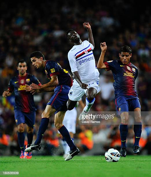 Pedro Obiang of Sampdoria duels for the ball with Marc Bartra and Jonathan Dos Santos of FC Barcelona during the Joan Gamper Trophy friendly match...