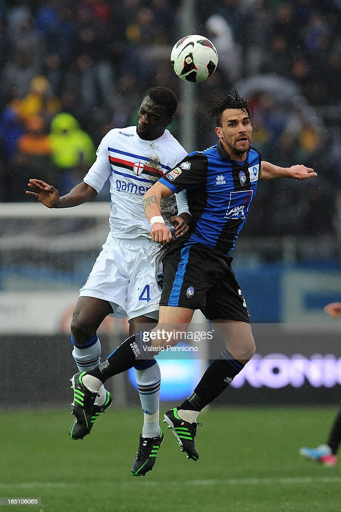 Pedro Obiang of UC Sampdoria competes for the ball in the air with <a gi-track='captionPersonalityLinkClicked' href=/galleries/search?phrase=Luca+Cigarini&family=editorial&specificpeople=3933790 ng-click='$event.stopPropagation()'>Luca Cigarini</a> (R) of Atalanta BC during the Serie A match between Atalanta BC and UC Sampdoria at Stadio Atleti Azzurri d'Italia on March 30, 2013 in Bergamo, Italy.