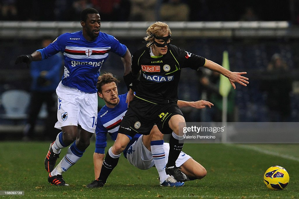 Pedro Obiang (L) of UC Sampdoria tackles Allan competes with Dusan Basta of Udinese Calcio during the Serie A match between UC Sampdoria and Udinese Calcio at Stadio Luigi Ferraris on December 10, 2012 in Genoa, Italy.