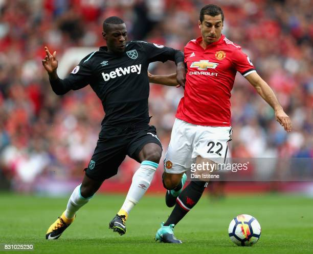 Pedro Obiang of West Ham United and Henrikh Mkhitaryan of Manchester United battle for possession during the Premier League match between Manchester...