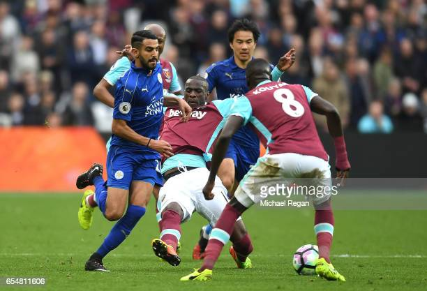 Pedro Obiang of West Ham United attempts to tackle Riyad Mahrez of Leicester City during the Premier League match between West Ham United and...
