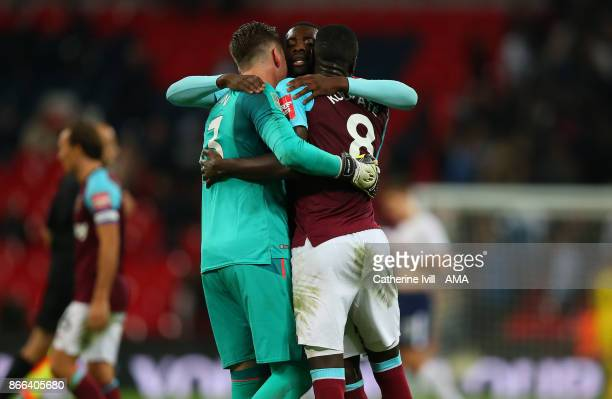 Pedro Obiang of West Ham United hugs Adrian and Cheikhou Kouyate of West Ham United after the Carabao Cup Fourth Round match between Tottenham...