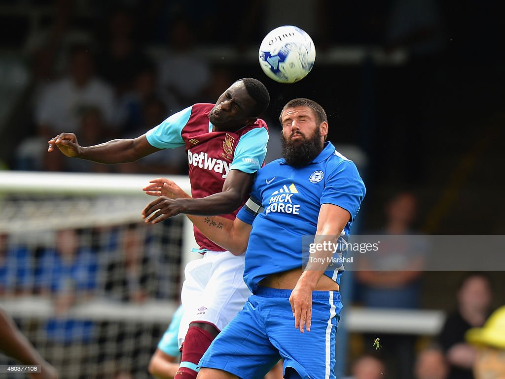 Pedro Obiang of West Ham United is tackled by Michael Bostwick of Peterborough United during the Pre Season Friendly match between Peterborough United and West Ham United at London Road Stadium on July 11, 2015 in Peterborough, England.