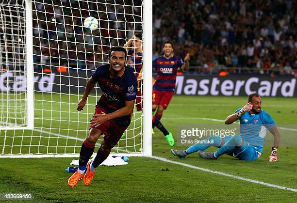 Pedro of Barcelona celebrates scoring their fifth goal past Beto of Sevilla in extra time during the UEFA Super Cup between Barcelona and Sevilla FC...