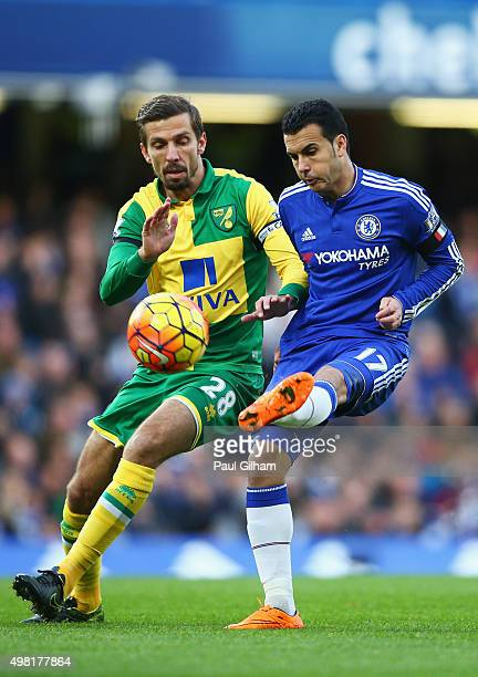 Pedro of Chelsea and Gary O'Neil of Norwich City compete for the ball during the Barclays Premier League match between Chelsea and Norwich City at...