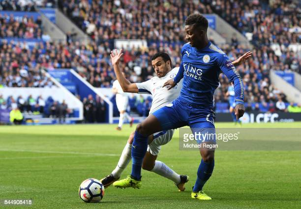 Pedro of Chelsea and Wilfred Ndidi of Leicester City battle for possession during the Premier League match between Leicester City and Chelsea at The...