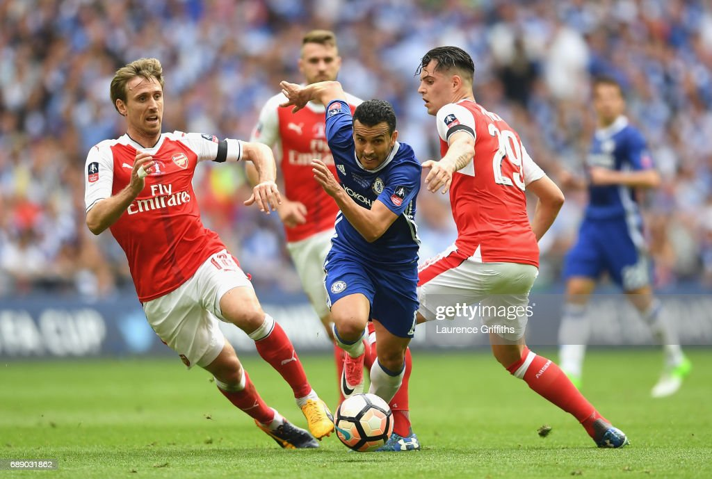 Pedro of Chelsea attempts to get past Nacho Monreal of Arsenal during The Emirates FA Cup Final between Arsenal and Chelsea at Wembley Stadium on May 27, 2017 in London, England.