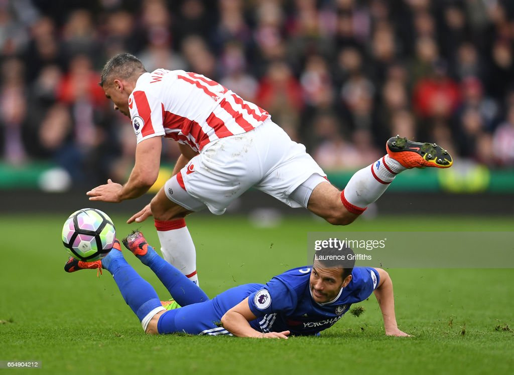 Pedro of Chelsea battles for the ball with Jonathan Walters of Stoke City during the Premier League match between Stoke City and Chelsea at Bet365 Stadium on March 18, 2017 in Stoke on Trent, England.