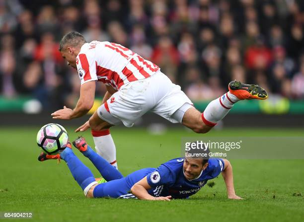 Pedro of Chelsea battles for the ball with Jonathan Walters of Stoke City during the Premier League match between Stoke City and Chelsea at Bet365...