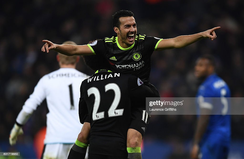 Pedro of Chelsea celebrate scoring with Willian during the Premier League match between Leicester City and Chelsea at The King Power Stadium on January 14, 2017 in Leicester, England.