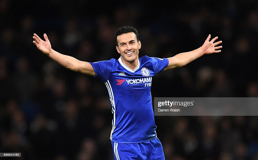 Pedro of Chelsea celebrates after scoring his second and his sides third goal during the Premier League match between Chelsea and AFC Bournemouth at Stamford Bridge on December 26, 2016 in London, England.