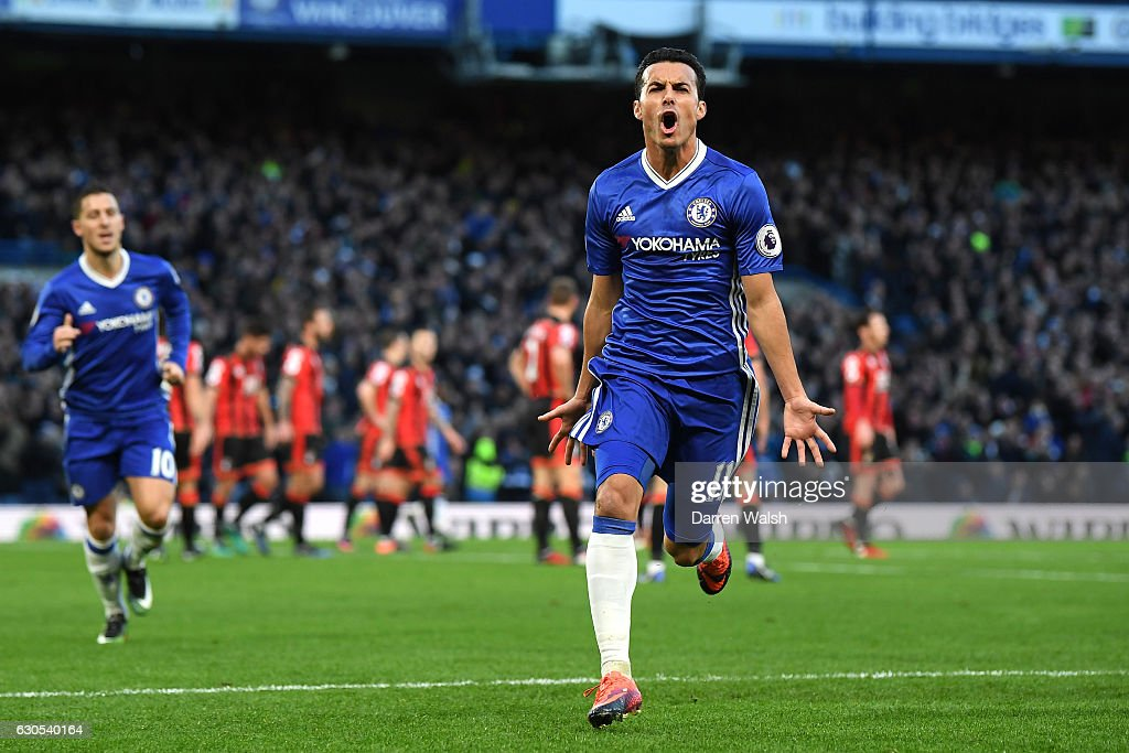 Pedro of Chelsea celebrates after scoring his sides first goal during the Premier League match between Chelsea and AFC Bournemouth at Stamford Bridge on December 26, 2016 in London, England.