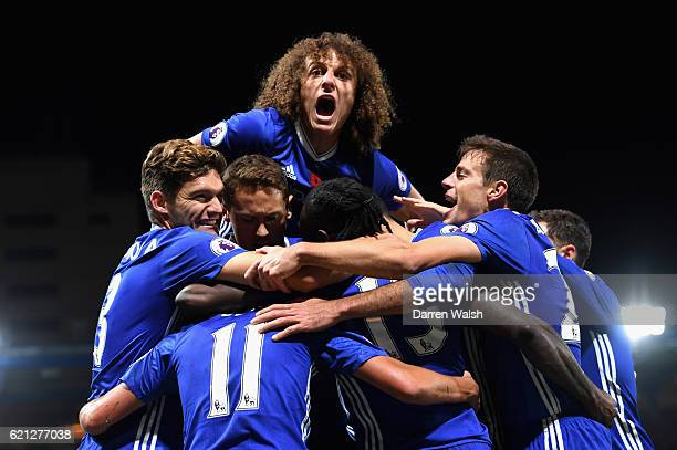 Pedro of Chelsea celebrates scoring his sides fifth goal with his Chelsea team mates during the Premier League match between Chelsea and Everton at...