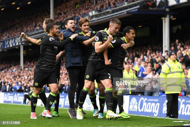 Pedro of Chelsea celebrates scoring his sides first goal with Gary Cahill of Chelsea and his Chelsea team mates during the Premier League match...