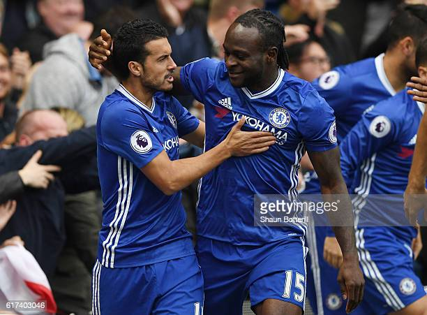 Pedro of Chelsea celebrates scoring his sides first goal with Victor Moses of Chelsea during the Premier League match between Chelsea and Manchester...