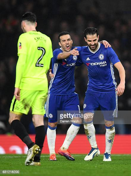 Pedro of Chelsea celebrates scoring his sides fourth goal with Cesc Fabregas of Chelsea during The Emirates FA Cup Third Round match between Chelsea...
