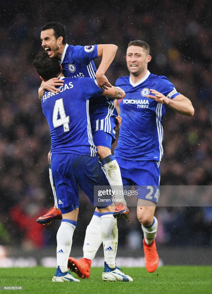 Pedro of Chelsea celebrates scoring his sides second goal with his Chelsea team mates during the Premier League match between Chelsea and Swansea City at Stamford Bridge on February 25, 2017 in London, England.