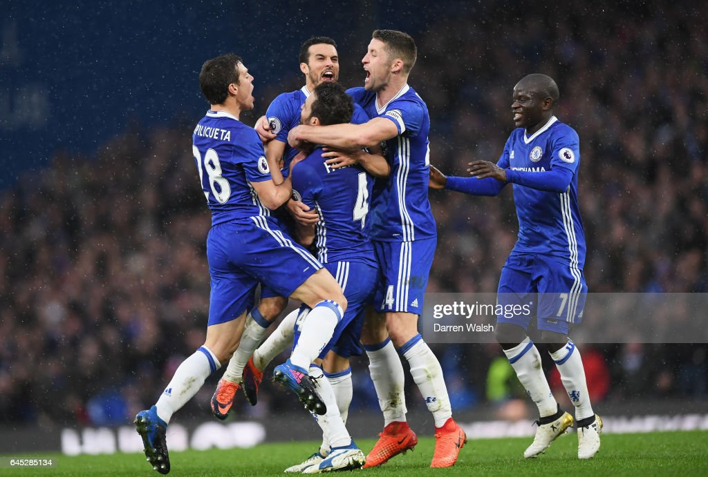 Pedro of Chelsea (C) celebrates scoring his sides second goal with his Chelsea team mates during the Premier League match between Chelsea and Swansea City at Stamford Bridge on February 25, 2017 in London, England.