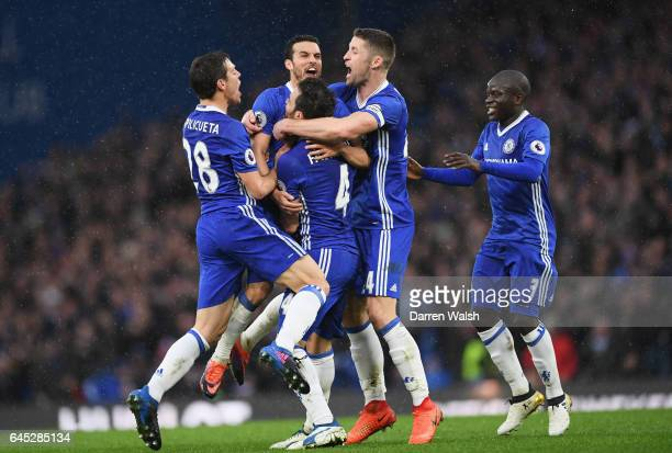 Pedro of Chelsea celebrates scoring his sides second goal with his Chelsea team mates during the Premier League match between Chelsea and Swansea...