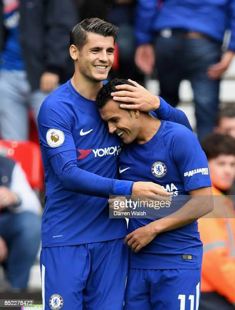 Pedro of Chelsea celebrates scoring his side's second goal with his team mate Alvaro Morata during the Premier League match between Stoke City and...