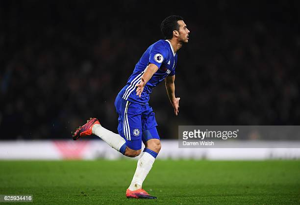 Pedro of Chelsea celebrates scoring his team's first goal during the Premier League match between Chelsea and Tottenham Hotspur at Stamford Bridge on...