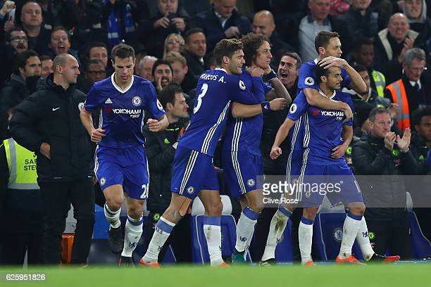 Pedro of Chelsea celebrates scoring his team's first goal with his team mates during the Premier League match between Chelsea and Tottenham Hotspur...