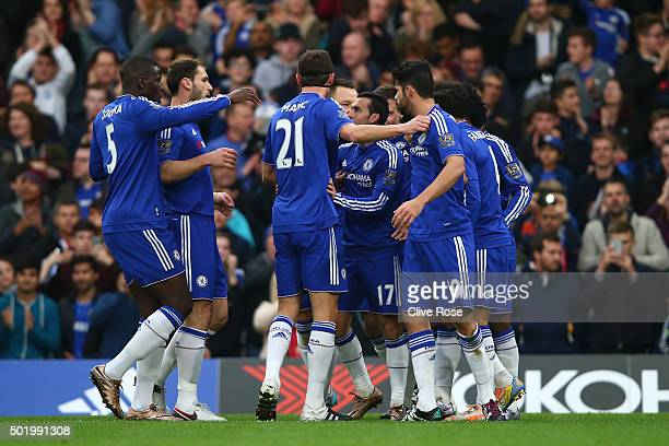 Pedro of Chelsea celebrates scoring his team's second goal with his team mates during the Barclays Premier League match between Chelsea and...