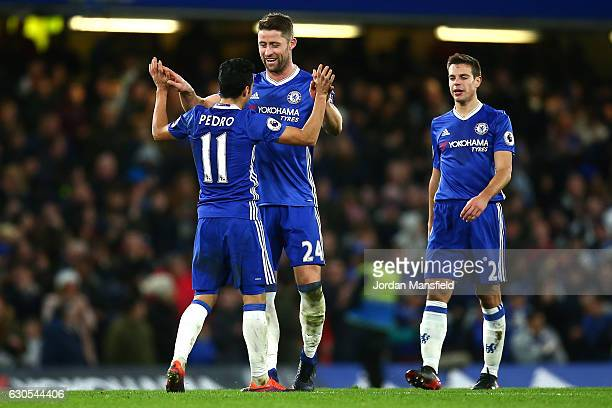 Pedro of Chelsea celebrates with Gary Cahill of Chelsea after scoring his second and his sides third goal during the Premier League match between...