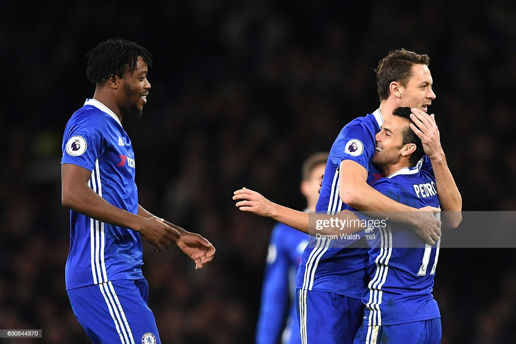 Pedro of Chelsea celebrates with Nemanja Maticl of Chelsea after scoring his second and his sides third goal during the Premier League match between Chelsea and AFC Bournemouth at Stamford Bridge on December 26, 2016 in London, England.