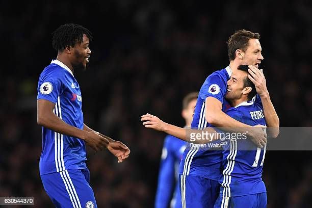 Pedro of Chelsea celebrates with Nemanja Maticl of Chelsea after scoring his second and his sides third goal during the Premier League match between...