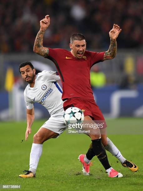 Pedro of Chelsea challenges Aleksandar Kolarov of AS Roma during the UEFA Champions League group C match between AS Roma and Chelsea FC at Stadio...