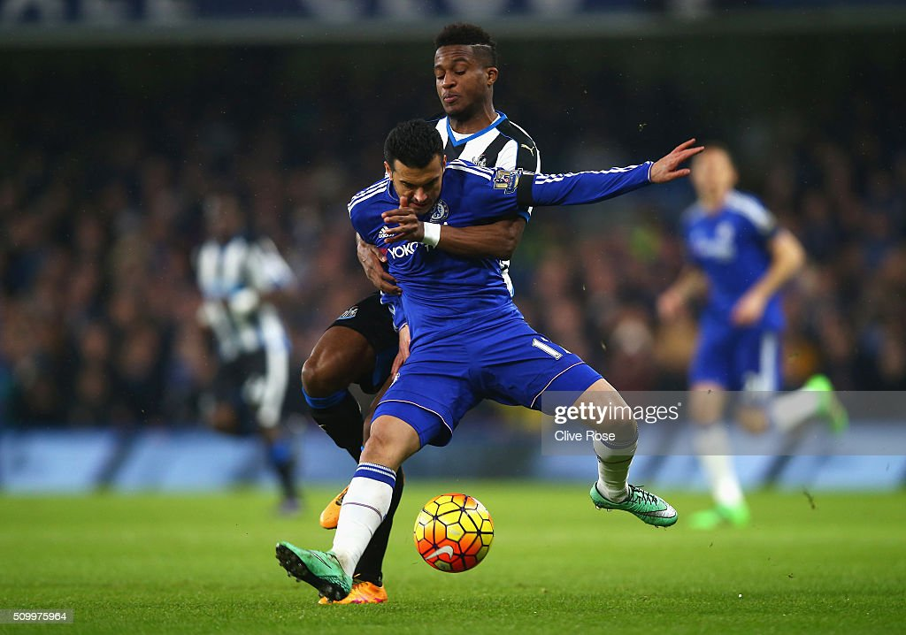 Pedro of Chelsea controls the ball under pressure of <a gi-track='captionPersonalityLinkClicked' href=/galleries/search?phrase=Rolando+Aarons&family=editorial&specificpeople=12380775 ng-click='$event.stopPropagation()'>Rolando Aarons</a> of Newcastle United during the Barclays Premier League match between Chelsea and Newcastle United at Stamford Bridge on February 13, 2016 in London, England.