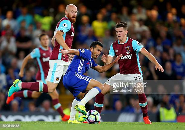 Pedro of Chelsea in action with James Collins and Sam Byram of West Ham during the Premier League match between Chelsea and West Ham United at...