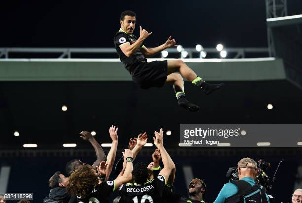 Pedro of Chelsea is chucked in the air by his team mates as they celebrate winning the leauge after the Premier League match between West Bromwich...