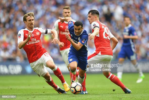 Pedro of Chelsea is closed down by Nacho Monreal and Granit Xhaka of Arsenal during The Emirates FA Cup Final between Arsenal and Chelsea at Wembley...