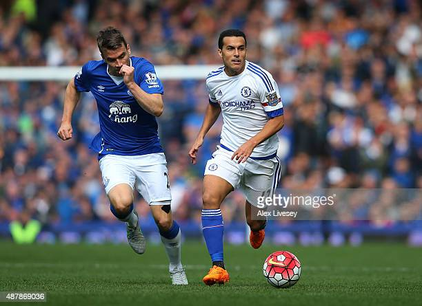 Pedro of Chelsea is closed down by Seamus Coleman of Everton during the Barclays Premier League match between Everton and Chelsea at Goodison Park on...