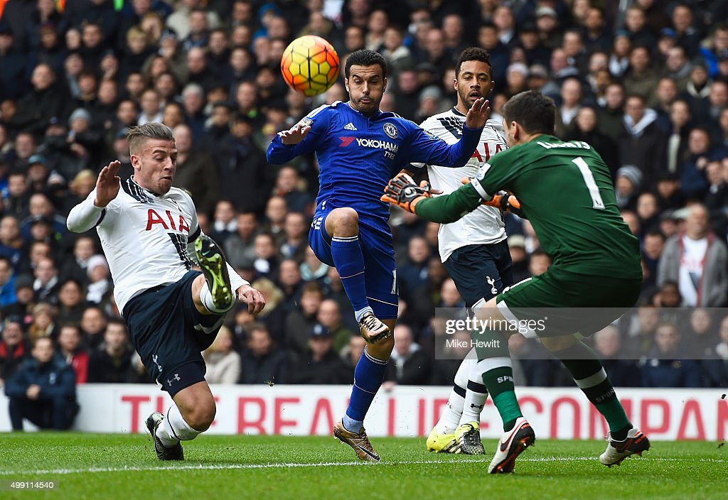 Pedro of Chelsea is marshalled by Toby Alderweireld (L), Mousa Dembele (2R) and goalkeeper Hugo Lloris of Tottenham Hotspur (R) during the Barclays Premier League match between Tottenham Hotspur and Chelsea at White Hart Lane on November 29, 2015 in London, England.