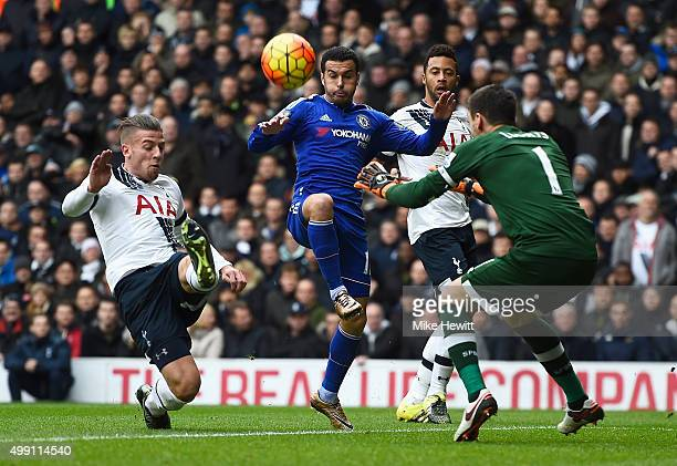 Pedro of Chelsea is marshalled by Toby Alderweireld Mousa Dembele and goalkeeper Hugo Lloris of Tottenham Hotspur during the Barclays Premier League...