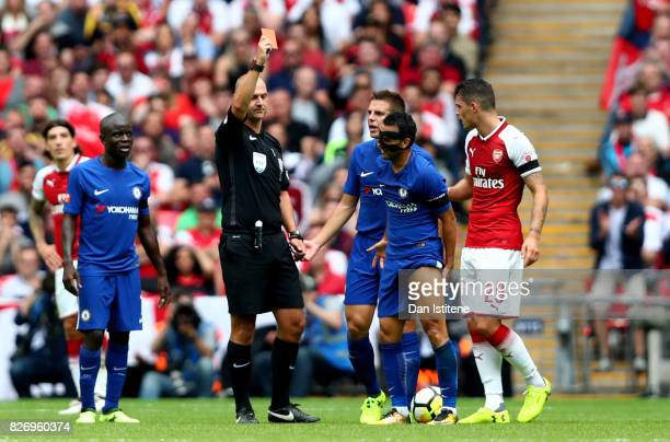 Pedro of Chelsea is shown a red card by Referee Bobby Madley during the The FA Community Shield final between Chelsea and Arsenal at Wembley Stadium...