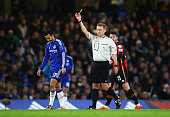 Pedro of Chelsea is shown a yellow card by referee Mike Jones during the Barclays Premier League match between Chelsea and AFC Bournemouth at...