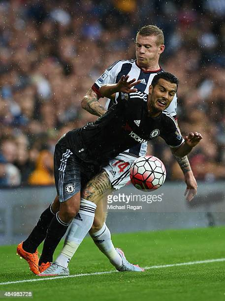 Pedro of Chelsea is tackled by James McClean of West Bromwich Albion during the Barclays Premier League match between West Bromwich Albion and...