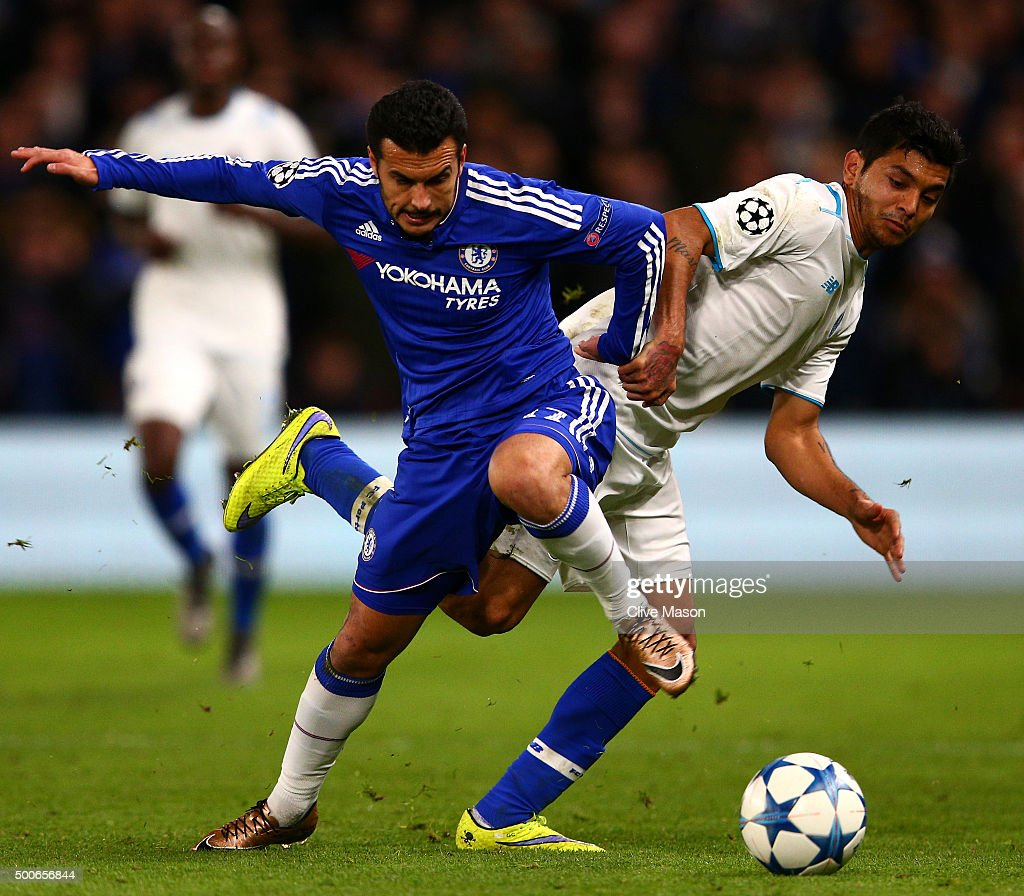 Pedro of Chelsea is tackled by Jesus Manuel Corona of FC Porto during the UEFA Champions League Group G match between Chelsea FC and FC Porto at Stamford Bridge on December 9, 2015 in London, United Kingdom.