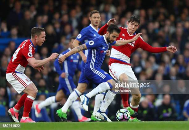 Pedro of Chelsea is tackled by Marten de Roon of Middlesbrough during the Premier League match between Chelsea and Middlesbrough at Stamford Bridge...