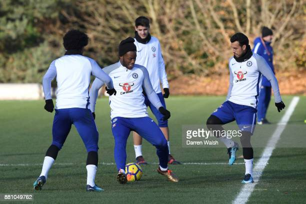 Pedro of Chelsea nutmegs Michy Batshuayi during a training session at Chelsea Training Ground on November 28 2017 in Cobham England