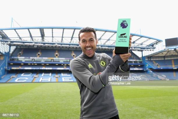 Pedro of Chelsea poses for the camera with his Carling Goal of the Month award at Stamford Bridge on May 11 2017 in London England