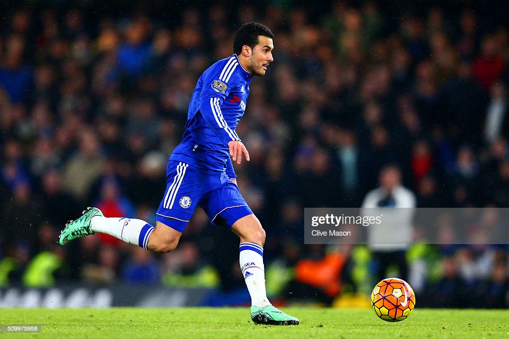 Pedro of Chelsea runs with the ball to score his team's second goal during the Barclays Premier League match between Chelsea and Newcastle United at Stamford Bridge on February 13, 2016 in London, England.